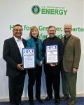 ECA Auto Tom Tabor presenting the awards to ORNL Director of Ind. Partnerships Suzy Tichenor and Assoc. Lab. Director Jeff Nichols