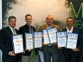 Jeff Hyman joins SGI CMO Bob Braham and CEO Luis Titinger as they accept SGI's awards from CEO Tom Tabor