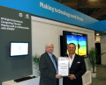 Ed Turkel, WW HPC Marketing at HP accepts award from Tom Tabor, CEO and Founder, Tabor Communications Inc. and HPCwire.